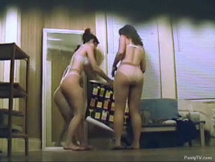 two chicks Getting Their Pantyhose On .