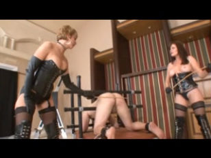 2 Leather  Dommes in Boots and Stoc.