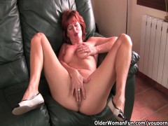 Redheaded old mom plays with her nipples and vagina