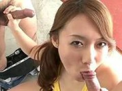 Japanese babe blows on two cocks