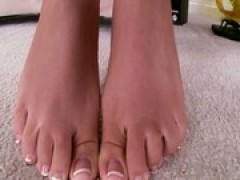 blonde footlover tugs with her feet