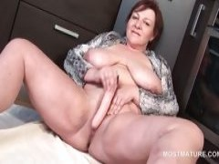 Redhead old masturbating with dildo at home