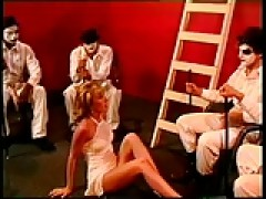 blondy girl swallows four rods at once in studio then rides