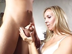 enormous titties lady giving handjob