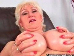 old lady with monstrous tits finger fucks her sweet matured snatch