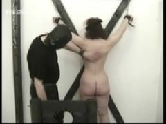 Brunette slave got hit with a whip on her .