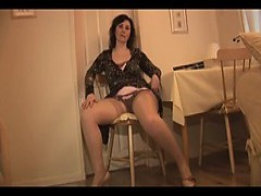 older English lady In Slip And Stockings Strips And Teases
