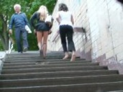 Seducing Hot Bodied broad In Fishnet Stockings And Short Skirt Shows Upskirt On Stairs
