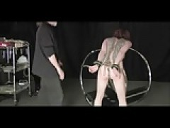 Spanked And hot Waxed On A Bondage Wheel