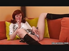 Redheaded beauty Muza plows her cu.