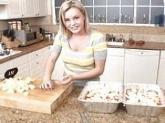 sweet young Bree Olson baking in her kitchen