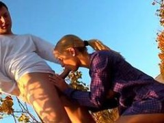 Outdoors teenie sex in doggystyle pose
